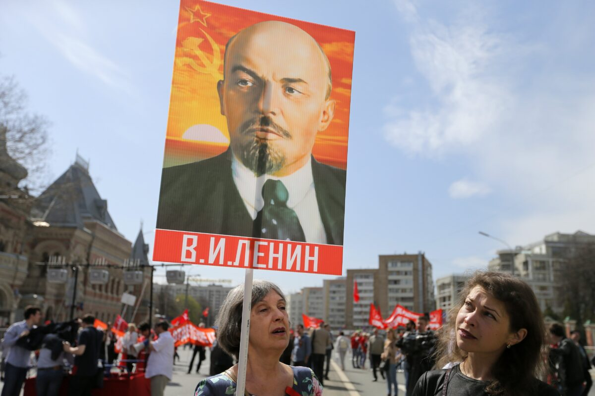 epa05938773 Members of Russian Communist party hold Lenin's portrait as they take part in the traditional May Day demonstration, Moscow, Russia, 01 May 2017. Labor Day, or May Day, is observed all over the world on the first day of May to celebrate the economic and social achievements of workers and fight for laborers rights. EPA/MAXIM SHIPENKOV