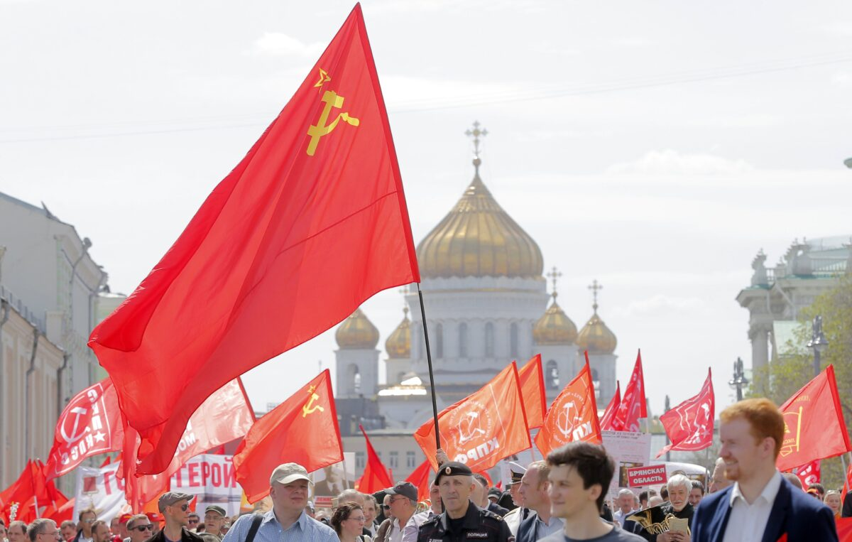 epa05938780 Russian Communist party members and supporters take part in the traditional May Day demonstration, Moscow, Russia, 01 May 2017. Labor Day, or May Day, is observed all over the world on the first day of May to celebrate the economic and social achievements of workers and fight for laborers rights. EPA/MAXIM SHIPENKOV