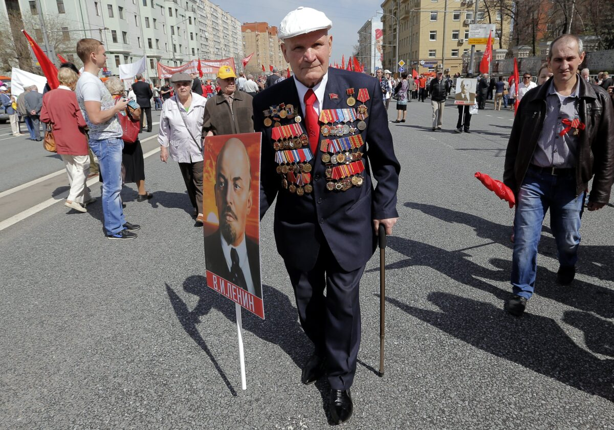 epa05938784 Members of Russian Communist party hold Lenin's portrait as they take part in the traditional May Day demonstration, Moscow, Russia, 01 May 2017. Labor Day, or May Day, is observed all over the world on the first day of May to celebrate the economic and social achievements of workers and fight for laborers rights. EPA/MAXIM SHIPENKOV