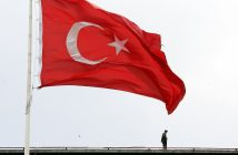 epaselect epa05938686 A Turkish special task force policeman stands guard on a top of a building nearby a giant Turkish flag as part of security measures to stop May Day celebrations in Taksim Square Istanbul, Turkey, 01 May 2017. According to reports, Turkish police imposed tight security measures around Taksim Square after interior ministry denied permits for celebrations to mark Labors Day in the square. Labour Day or May Day is observed all over the world on the first day of the May to celebrate the economic and social achievements of workers and fight for labourers rights.  EPA/Cem Turkel