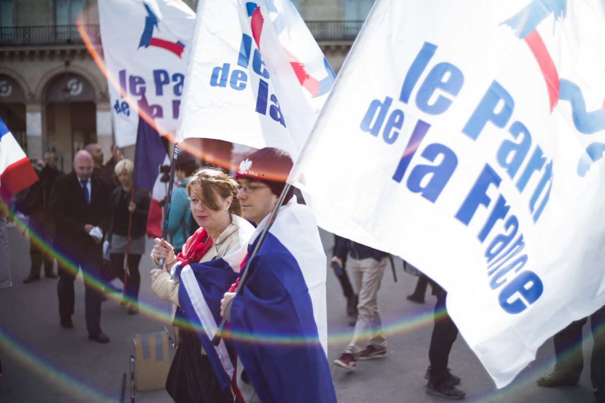 epa05938648 Supporters of Former President of the Front National (FN) far-right party Jean-Marie Le Pen walk during the rally by the statue of Joan of Arc in Paris, France, 01 May 2017. Labor Day, or May Day, is observed all over the world on the first day of May to celebrate the economic and social achievements of workers and fight for laborers rights. EPA/YOAN VALAT