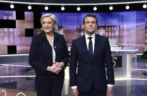 epa05942617 French presidential election candidate for the far-right Front National (FN) party, Marine Le Pen (L), and French presidential election candidate for the 'En Marche!' (Onwards!) political movement, Emmanuel Macron (R), pose prior to the start of a live brodcast face-to-face televised debate in television studios of French public national television channel France 2, and French private channel TF1 in La Plaine-Saint-Denis, north of Paris, France, on 03 May 2017 as part of the second round election campaign. Pro-EU centrist Emmanuel Macron and far-right leader Marine Le Pen face off in a final televised debate on 03 May that will showcase their starkly different visions of France's future ahead of this weekend's presidential election run-off.  EPA/ERIC FEFERBERG / POOL MAXPPP OUT