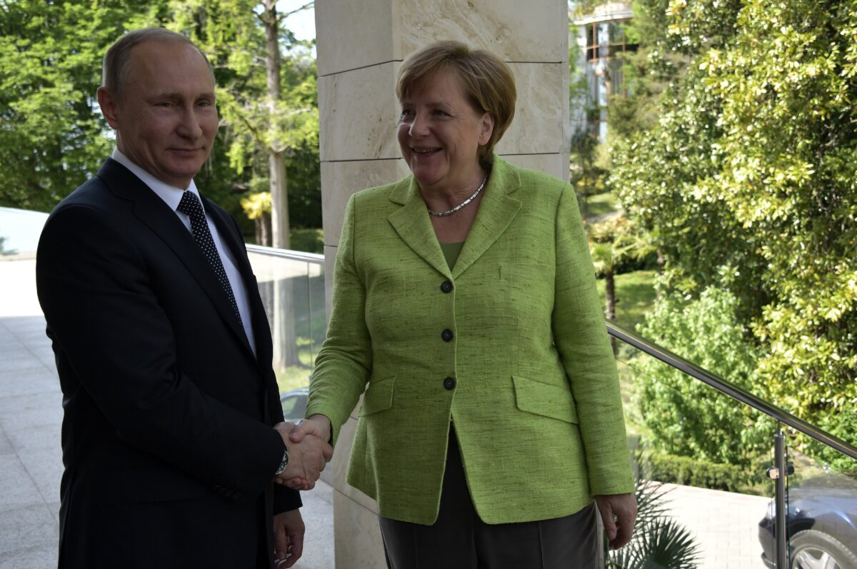 epa05940440 Russian President Vladimir Putin (L) and German Chancellor Angela Merkel (R) shake hands during their meeting at the Bocharov Ruchei residence in the Black sea resort of Sochi, Russia, 02 May 2017. The leaders are expected to discuss prospects of bilateral relations, and also Ukrainian crisis settlement and situation in Syria. EPA/ALEXEY NIKOLSKY / SPUTNIK / KREMLIN POOL MANDATORY CREDIT