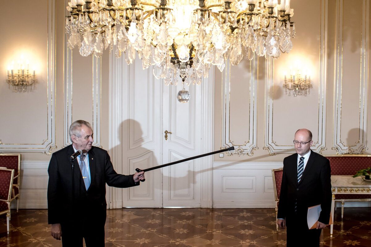 epa05943868 Czech President Milos Zeman (L) points his walking stick at Czech Prime Minister Bohuslav Sobotka (R) as he welcomes him for their talks at the Prague Castle in Prague, Czech Republic, 04 May 2017. Sobotka according to media reports on 02 April said he found it 'unbearable that Andrej Babis remained on the post of Finance Minister', after recent allegations of Babis having evaded taxes and announced that he plans to submit the resignation of his cabinet to President Zeman. EPA/MARTIN DIVISEK