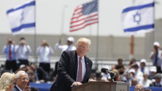 epa05981101 Israeli President Reuven Rivlin (2-L) listens to US President Donald J. Trump (R) speaking on the podium after arriving at Ben Gurion Airport in Lod, outside Tel Aviv, Israel, 22 May 2017. Trump arrived for a 28-hour visit to Israel and the Palestinian Authority areas on his first foreign trip since taking office in January.  EPA/ABIR SULTAN