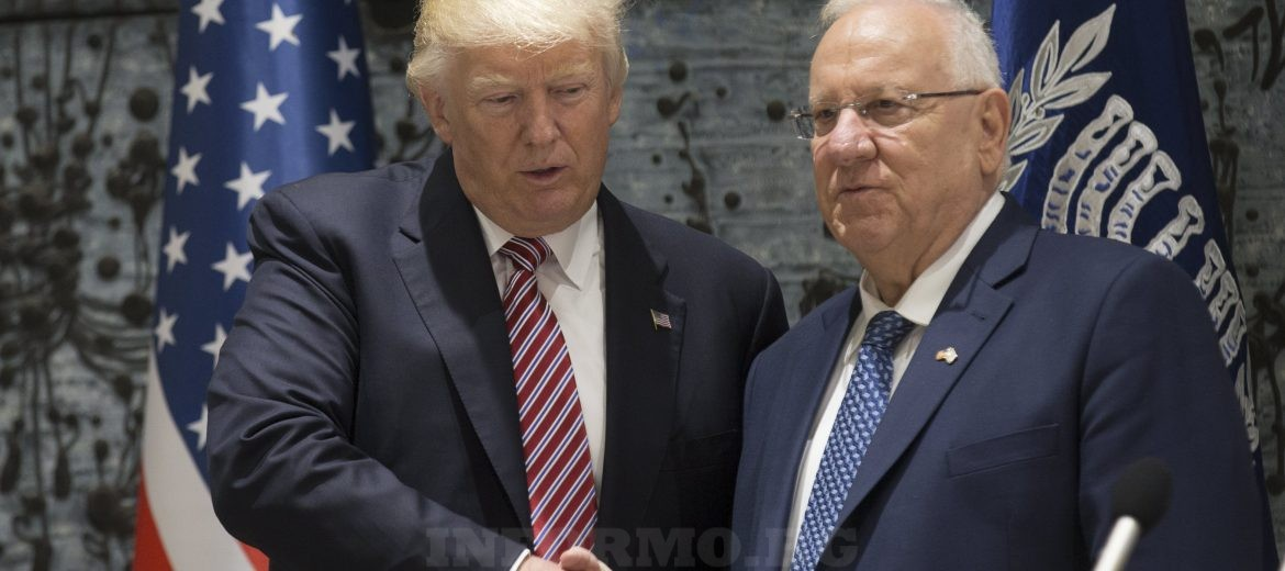 epa05981675 US President Donald J. Trump (L) and Israeli President Reuven Rivlin (R) shake hands after they delivered statements to the media upon their arrival at Rivlin's residence in Jerusalem, Israel, 22 May 2017. Trump arrived for a 28-hour visit to Israel and the Palestinian Authority areas on his first foreign trip since taking office in January.  EPA/ATEF SAFADI