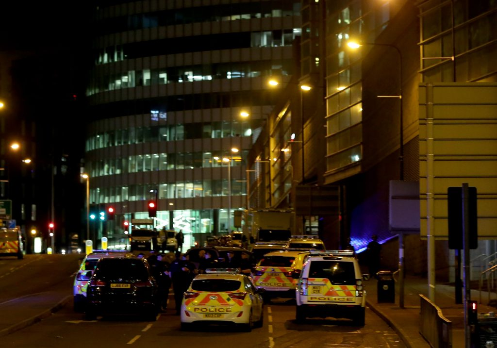 epa05982573 Emergency vehicles are seen outside the Manchester Arena following reports of an explosion, in Manchester, Britain, 23 May 2017. According to a statement released by the Greater Manchester Police on 23 May 2017, police responded to reports of an explosion at Manchester Arena on 22 May 2017 evening. At least 19 people have been confirmed dead and others 50 were injured, authorities said. The happening is currently treated as a terrorist incident until police know otherwise. According to reports quoting witnesses, a mass evacuation was prompted after explosions were heard at the end of US singer Ariana Grande's concert in the arena.  EPA/NIGEL RODDIS