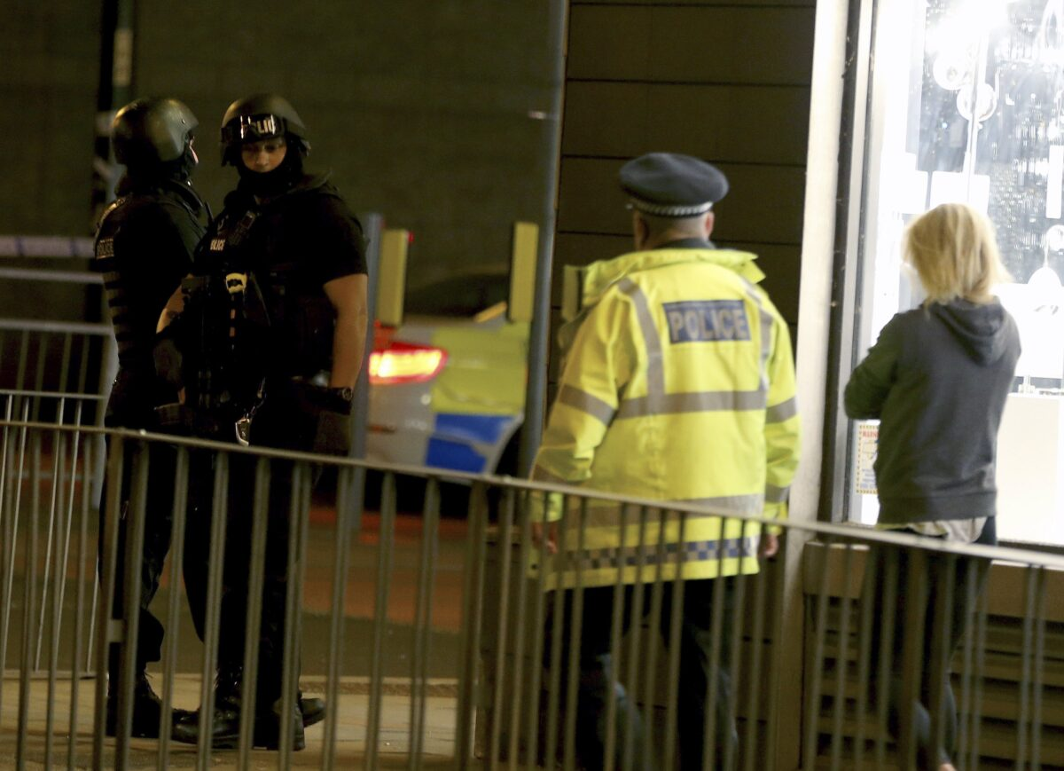epa05982626 Armed officers patrol near the Manchester Arena following reports of an explosion, in Manchester, Britain, 23 May 2017. According to a statement released by the Greater Manchester Police on 23 May 2017, police responded to reports of an explosion at Manchester Arena on 22 May 2017 evening. At least 19 people have been confirmed dead and around 50 others were injured, authorities said. The happening is currently treated as a terrorist incident until police know otherwise. According to reports quoting witnesses, a mass evacuation was prompted after explosions were heard at the end of US singer Ariana Grande's concert in the arena. EPA/NIGEL RODDIS