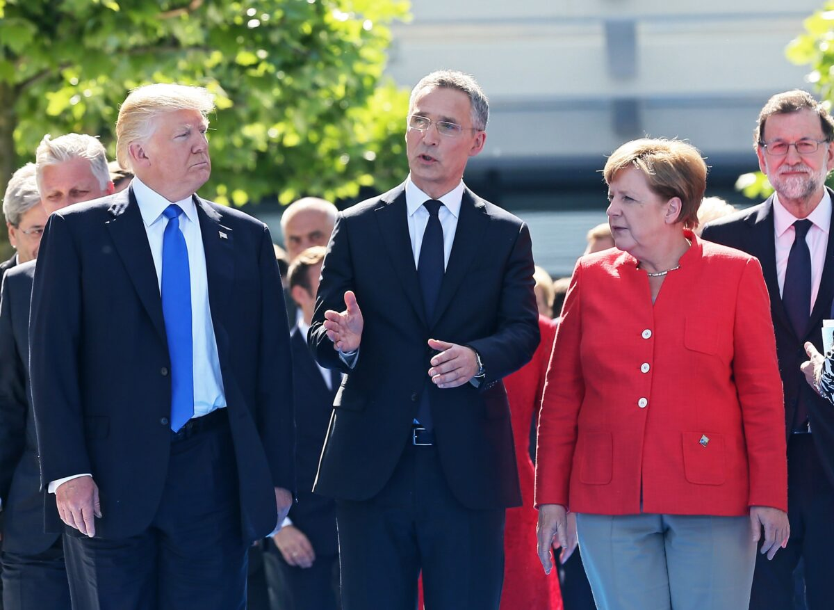 epa05989722 (front L-R) US President Donald J. Trump, NATO Secretary General Jens Stoltenberg, and German Chancellor Angela Merkel, and Spanish Prime Minister Mariano Rajoy walk with fellow dignitaries during the unveiling of a monument at the new NATO Headquarters during the NATO summit in Brussels, Belgium, 25 May 2017. NATO countries' heads of states and governments gather in Brussels for a one-day meeting.  EPA/STEPHANIE LECOCQ