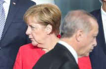 epa05989742 German Chancellor Angela Merkel (L) looks on as Turkish President Recep Tayyip Erdogan (R) walks by, during a line up for the group photo at the NATO summit in Brussels, Belgium, 25 May 2017. NATO countries' heads of states and governments gather in Brussels for a one-day meeting.  EPA/ARMANDO BABANI