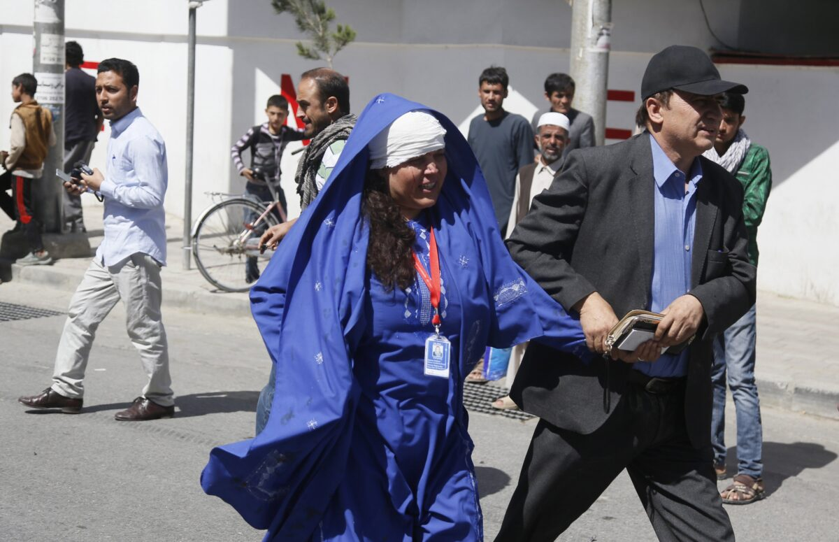 epa06000537 A woman who was injured in a suicide bomb attack, is helped by a man in Kabul, Afghanistan, 31 May 2017. At least 50 people were killed or wounded in a suicide bomb attack near Kabul's diplomatic and government district on 31 May, media reported. The number of casualties is expected to rise, media added. EPA/JAWAD JALALI