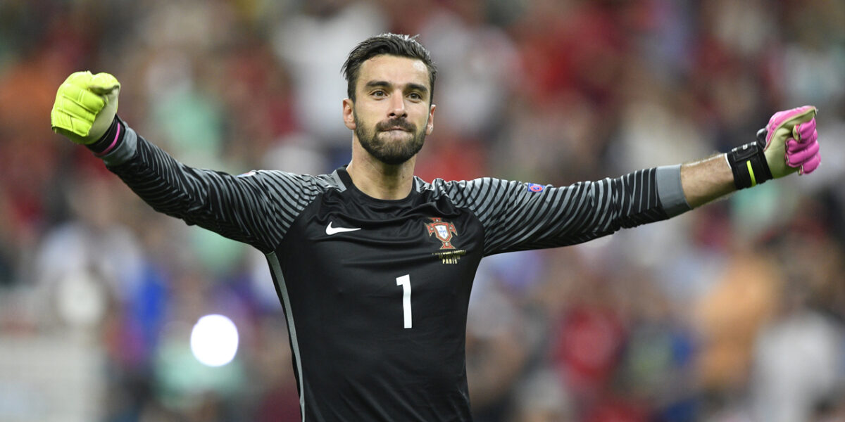 Portugal's goalkeeper Rui Patricio reacts after Portugal beat their hosts France 1-0 in the Euro 2016 final football match between France and Portugal at the Stade de France in Saint-Denis, north of Paris, on July 10, 2016. / AFP PHOTO / MARTIN BUREAU