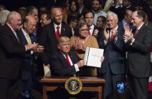 epa06032094 US President Donald J. Trump shows the National Security Presidential Memorandum on Cuba, he signed after giving remarks at Manuel Artime Theater in Miami, Florida, USA on 16 June 2017.  EPA/Cristobal Herrera