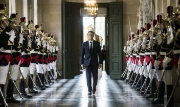 epaselect epa06063373 French President Emmanuel Macron walks through the Galerie des Bustes (Busts Gallery) to access the Versailles Palace's hemicycle were he gathered French parliamentarians and senators in order to deliver the main outlines of his policy in Versailles near Paris, France, 03 July 2017. The gathering takes place the day before French Prime Minister Edouard Philippe's general policy speech at the French Parliament.  EPA/ETIENNE LAURENT/POOL MAXPPP OUT