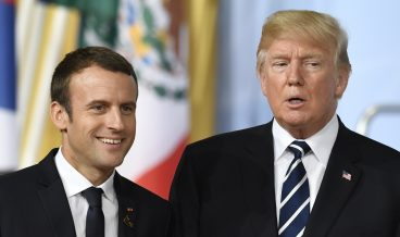 epa06072608 French President Emmanuel Macron (L) and US President Donald J. Trump (R) before the family picture on the opening day of the G20 summit in Hamburg, Germany, 07 July 2017. The G20 Summit (or G-20 or Group of Twenty) is an international forum for governments from 20 major economies. The summit is taking place in Hamburg 07 to 08 July 2017.  EPA/DANIEL KOPATSCH