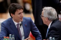 epa06075416 Canadian Prime Minister Justin Trudeau (L) and President of the European Commission Jean-Claude Juncker chat prior to the morning working session on the second day of the G20 economic summit in Hamburg, Germany 08 July 2017. The G20 Summit (or G-20 or Group of Twenty) is an international forum for governments from 20 major economies. The summit is taking place in Hamburg 07 to 08 July 2017.  EPA/SEAN GALLUP / POOL
