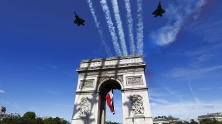 epa06086527 French military aircrafts fly over the Arc de Triomphe during the Bastille Day military parade on the Champs Elysees avenue in Paris, France, 14 July 2017. Bastille Day, the French National Day, is held annually on 14 July to commemorate the storming of the Bastille fortress in 1789.  EPA/ETIENNE LAURENT/POOL MAXPPP OUT