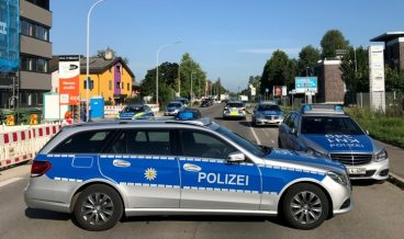 epa06117052 Police block the street leading to the night club 'Grey' in Konstanz, Germany, 30 July 2017. According to media reports, several people were injured in a shooting at the club in the early morning.  EPA/OLIVER HANSER