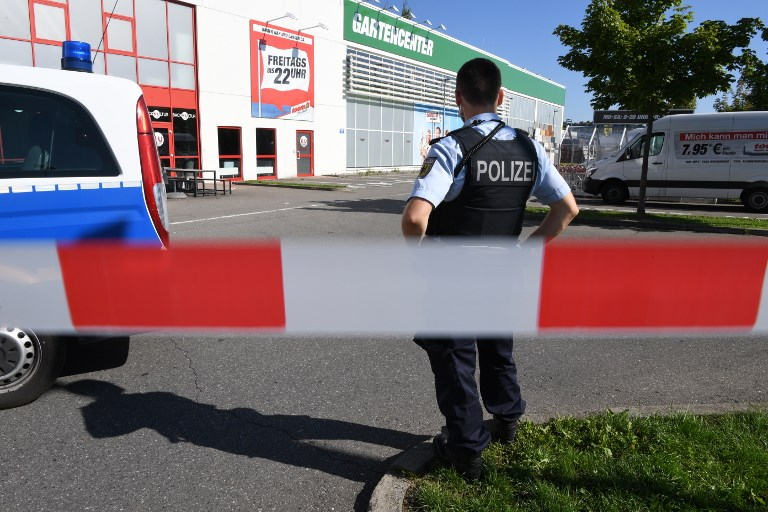 """The 34-year-old attacker """"was critically injured in a shootout with police officers as he left the disco, and later succumbed to his wounds in hospital,"""" police said in a statement.  / AFP PHOTO / dpa / Felix Kästle / Germany OUT"""