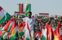 epa06220267 A Kurd holds Kurdish flags during a rally for the Kurdistan independence referendum campaign at the Franso Hariri stadium in Erbil, Iraq, 22 September 2017. The Kurdistan region is an autonomous region in northern Iraq since 1991, with an estimated population of 5.3 million people. The region share borders with Turkey, Iran, and Syria, all of which have large Kurdish minorities. On 25 September the Kurdistan region will hold a referendum for independence and the creation of the state of Kurdistan amidst divided international support.  EPA/MOHAMED MESSARA