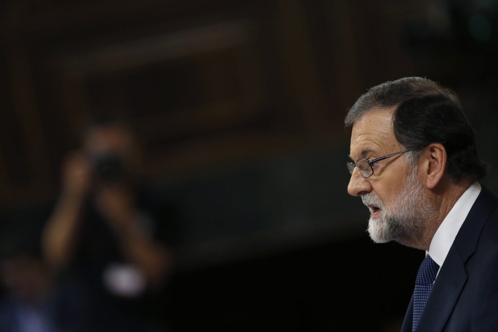 epa06259355 Spanish Prime Minister Mariano Rajoy delivers a speech during Question Time at the Lower House in Madrid, Spain, 11 October 2017. The Government will undergo Question Time a day after Catalonia's regional President Carles Puigdemont declared the region's independence but suspended its effects immediately for a few weeks to search a dialogue with the Spanish Central Government.  EPA/Javier Lizon