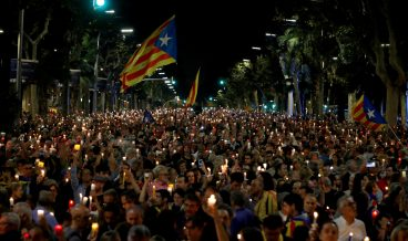 epa06271830 Thousands of people protest in downtown Barcelona, Spain, 17 October 2017. Demonstrators are protesting the imprisonment of leaders of independent organizations, Catalonian National Assembly, Jordi Sanchez, and Omnium Cultural, Jordi Cuixart. National Court magistrate Carmen Lamela sent  Sanchez and Cuixart to prison for a sedition offense.  EPA/Alberto Estevez