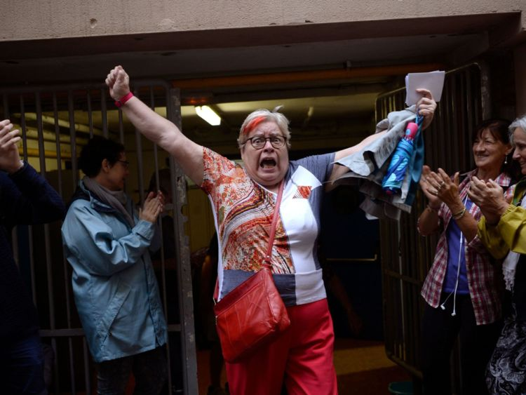 A woman celebrates outside a polling station after casting her vote in Barcelona, on October 01, 2017, in a referendum on independence for Catalonia banned by Madrid. Madrid has vowed to stop the referendum from going ahead, closing polling stations, seizing millions of ballot papers, detaining key organisers and shutting down websites promoting the vote.  / AFP PHOTO / Josep LAGO        (Photo credit should read JOSEP LAGO/AFP/Getty Images)