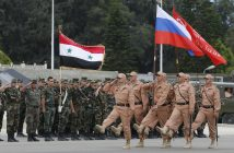 Russian soldiers march during a rehearsal of Victory Day parade, in which they will take part with a Syrian unit at Hmeimym airbase in Latakia province, Syria, 04 May 2016 (reissued 11 December 2017). Media reports on 11 December 2017 state Russian President Vladimir Putin made an unannounced visit to Syria where he met with Syrian Presidents Bashar al-Assad and ordered a withdrawal of Russian troops from Syria.  EPA/SERGEI CHIRIKOV *** Local Caption *** 52738599