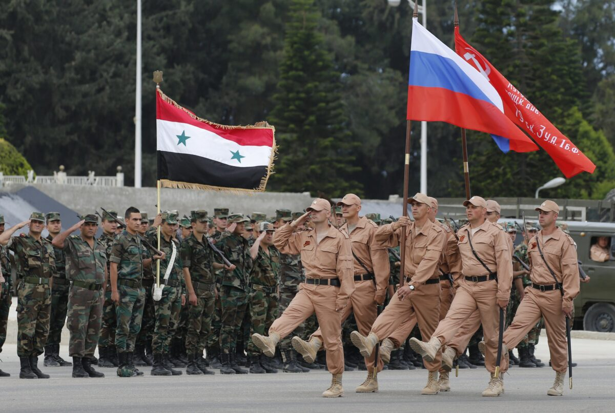 epa06382523 (FILE) - Russian soldiers march during a rehearsal of Victory Day parade, in which they will take part with a Syrian unit at Hmeimym airbase in Latakia province, Syria, 04 May 2016 (reissued 11 December 2017). Media reports on 11 December 2017 state Russian President Vladimir Putin made an unannounced visit to Syria where he met with Syrian Presidents Bashar al-Assad and ordered a withdrawal of Russian troops from Syria.  EPA/SERGEI CHIRIKOV *** Local Caption *** 52738599