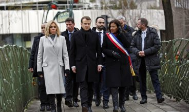 epa06422559 French President Emmanuel Macron, center, his wife Brigitte, left, and Paris mayor Anne Hidalgo arrive to observe a minute of silence in front of the  plaque commemorating late police officer Ahmed Merabet to mark the third anniversary of the attack, in Paris, France, 07 January 2018. Macron paid respects to the 17 people killed when Islamic extremists attacked satirical newspaper Charlie Hebdo and a kosher supermarket three years ago on 07 January 2015.  EPA/Christophe Ena / POOL MAXPPP OUT