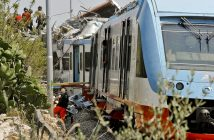 A view of the scene of a train accident after two commuter trains collided head-on near the town of Andria, in the southern region of Puglia, killing several people, Tuesday, July 12, 2016.  (Luca Turi/ANSA via AP)