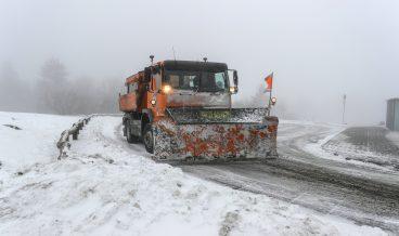 Snow plough clears a street during snowfall in Feldberg Mountain in Taunus