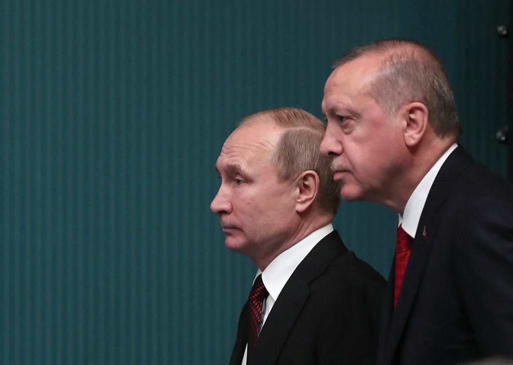 epa06643700 Turkish President Recep Tayyip Erdogan (R) and Russian President Vladimir Putin (L) attend a press conference after their meeting at the Presidential Palace in Ankara, Turkey, 03 April 2018. Putin is in Ankara on a two-day official visit at the invitation of Turkish President Recep Tayyip Erdogan. The agenda includes Putin's participation in a trilateral meeting on 04 April, with Erdogan and Iranian President Hassan Rouhani to discuss settlement in Syria.  EPA/TOLGA BOZOGLU