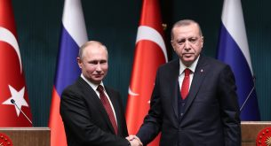 epa06643801 Turkish President Recep Tayyip Erdogan (R) shaking hands with Russian President Vladimir Putin (L) during a press conference after their meeting at the Presidential Palace in Ankara, Turkey 03 April 2018. Erdogan and Putin will attend a ceremony for a symbolic ground-breaking of Turkey's first nuclear plant on the Mediterranean coast at Akkuyu, during a High-Level Cooperation Council meeting in Ankara. Putin and Erdogan will also meet with Iranian President Hassan Rouhani in a summit on 04 April for Syria talks.  EPA/TUMAY BERKIN