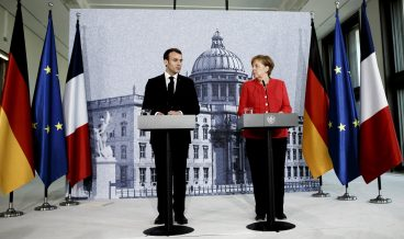 epa06679420 German Chancellor Angela Merkel (R) and French President Emmanuel Macron (L) attend a pressconference following a visit at the Humboldt Forum construction site in Berlin, Germany, 19 April 2018. The two leaders are meeting following Macron's delivery of an impassioned speech at the European Parliament on 17 April, in which he urged reforms to further bind EU member states together and to counter authoritarianism. The Humboldt Forum, to be located in the reconstructed Berlin City Palace, in German called the Berliner Schloss, will draw on the collections of other Berlin museums and is to become the world's pre-eminent museum dedicated to non-Western art.  EPA/CARSTEN KOALL / POOL
