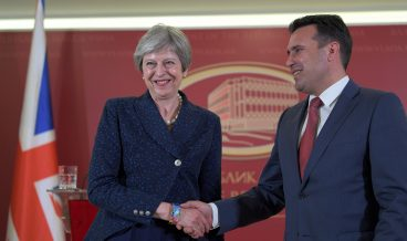 epa06745024 Macedonian Prime Minister Zoran Zaev (R) shakes hands with British Prime Minister Theresa May (L) in Skopje, The Former Yugoslav Republic of Macedonia (FYROM), 17 April 2018. Theresa May following a two-day EU summit in Sofia, Bulgaria, arrived for an official visit to FYROM.  EPA/GEORGI LICOVSKI