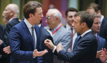 epaselect epa06847299 Austrian Chancellor Sebastian Kurz (L) and French President Emmanuel Macron (R) during an European Council summit in Brussels, Belgium, 28 June 2018. EU countries' leaders meet on 28 and 29 June for a summit to discuss migration in general, the installation of asylum-seeker processing centers in northern Africa, and other security- and economy-related topics including Brexit.  EPA/OLIVIER HOSLET