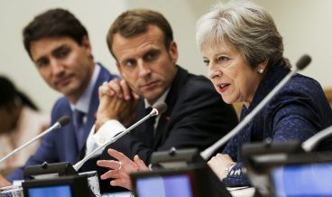 epa07047134 French President Emmanuel Macron (C) sits with Canadian Prime Minister Justin Trudeau (L) and British Prime Minister Theresa May (R) during an event called '12 Years to Break Barriers and Leave No Girl Behind:  Countdown to 2030' on the sidelines of the the General Debate of the General Assembly of the United Nations at United Nations Headquarters in New York, New York, USA, 25 September 2018. The General Debate of the 73rd session begins on 25 September 2018.  EPA/AMR ALFIKY / POOL