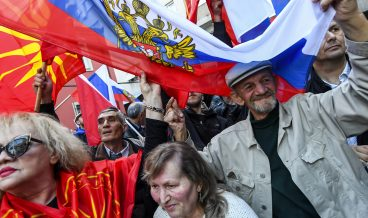 epa06643845 Macedonians, wave Russian and old Macedonian flags as a sign of support for Russia and to protest against their Government's decision to expel one Russian diplomat, in front of the Russian embassy in Skopje, The Former Yugoslav Republic of Macedonia on 03 April     2018. the Macedonian Government announced on 26 March 2018 that Macedonia would expel one Russian diplomat in a coordinated response to the use of a chemical weapon in the attempted murder of Sergei Skripal, a former Russian intelligence official, and his daughter, Yulia, in Salisbury on 04 March 2018.  EPA-EFE/GEORGI LICOVSKI