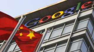 "A Chinese flag flies over the company logo outside the Google China headquarters in Beijing on January 14, 2010.  Google vowed to stop bowing to Chinese Internet censors and risk banishment from the lucrative market, in protest against ""highly sophisticated"" cyberattacks aimed at Chinese human rights activists. The authorities in the world's most populous nation regularly block content and websites they deem politically objectionable.   AFP PHOTO/LIU Jin (Photo credit should read LIU JIN/AFP/Getty Images)"