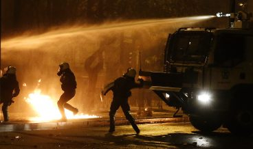 epa07173797 Riot policemen avoid a cocktail molotov during clashes that broke outside the Polytechnical University  after a demonstration in homage to the victims of a 1973 uprising against the military junta that ruled Greece from 1967 to 1974, in Athens, Greece, 17 November 2018. Events are being held throughout Greece to mark the 45th anniversary of the student uprising of 17 November 1973.  EPA/ALEXANDROS VLACHOS