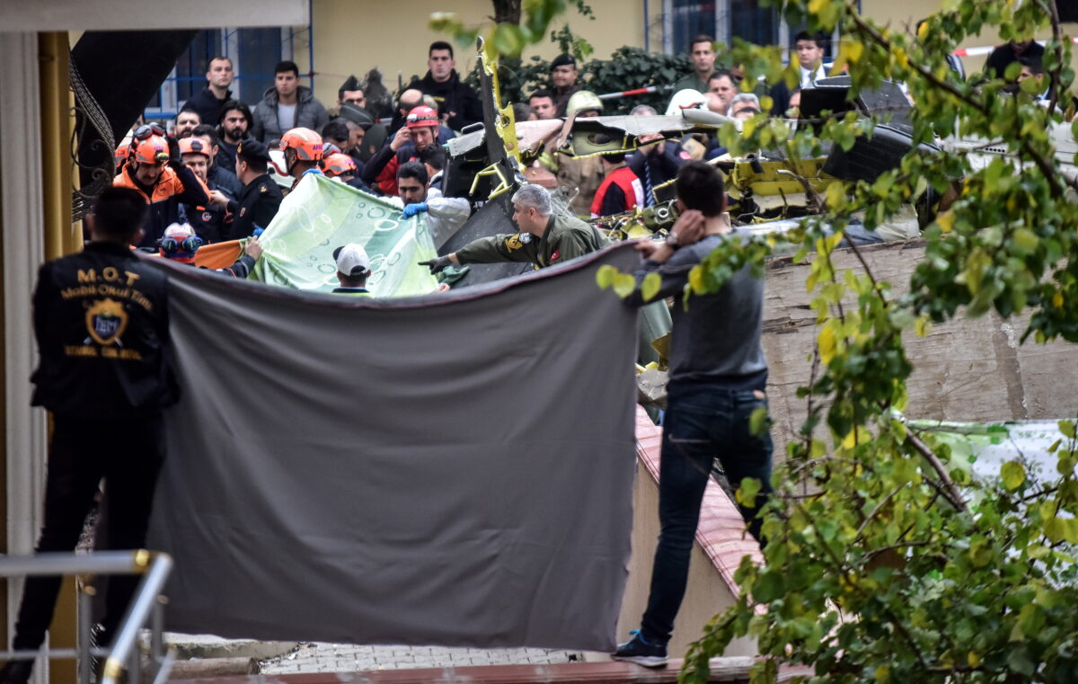 epa07190567 Rescue workers and investigators work at the site of a military helicopter crash in Istanbul, Turkey, 26 November 2018. According to reports, at least four soldiers died and one wounded in a crash of a Turkish military helicopter in Istanbul. EPA/IBRAHIM MASE