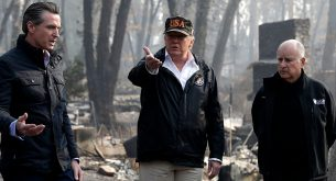 Mandatory Credit: Photo by Evan Vucci/AP/REX/Shutterstock (9983091aa) President Donald Trump talks with Gov.-elect Gavin Newsom, left, and as California Gov. Jerry Brown listens during a visit to a neighborhood impacted by the wildfires, in Paradise, Calif Trump California Wildfires, Paradise, USA - 17 Nov 2018