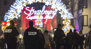 Police officers patrols the Christmas market in Strasbourg, eastern France, Tuesday, Dec. 20, 2016, the day after a truck ran into a crowded Christmas market and killing people Monday evening in Berlin, Germany. (AP Photo/Jean-Francois Badias)