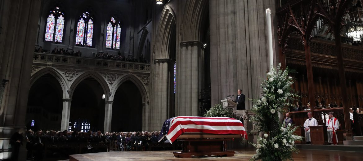 epa07210469 Former US President George W. Bush speaks in front of the flag-draped casket of his father, former US President George H.W. Bush, at the State Funeral at the National Cathedral, in Washington, DC, USA, 05 December 2018. George H. W. Bush, the 41st President of the United States (1989-1993), died in his Houston, Texas, USA, home surrounded by family and friends on 30 November 2018. The body will return to Houston for another funeral service before being transported by train to the George Bush Presidential Library and Museum for internment.  EPA/ALEX BRANDON / POOL