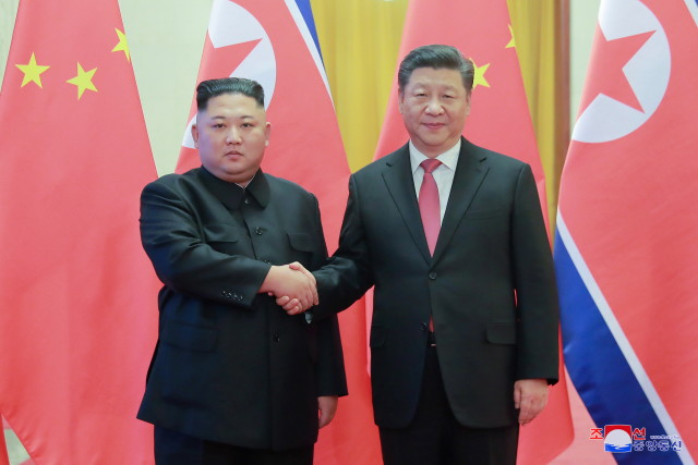 epa07272451 A photo released by the official North Korean Central News Agency (KCNA) shows North Korean leader Kim Jong-un (L) shaking hands with Chinese President Xi Jinping (R) during his visit in Beijing, China, 10 January 2019. North Korean leader Kim Jong-un is in China at the invitation of Chinese President Xi Jinping from 07 to 10 January with his wife Ri Sol-ju.  EPA/KCNA   EDITORIAL USE ONLY