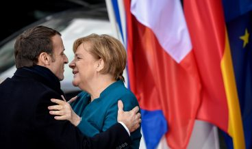 epaselect epa07308524 German Chancellor Angela Merkel (R) and French President Emmanuel Macron (L) arrive for the signing of a new Franco-German friendship treaty in Aachen, Germany, 22 January 2019. President Macron and Chancellor Merkel will sign a new friendship treaty, intended to supplement the 1963 Elysee Treaty, pledging to provide deeper economic and defense ties and commitment to the EU.  EPA/SASCHA STEINBACH