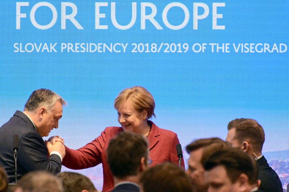 epa07350536 Prime Minister of Hungary Viktor Orban (L) kisses German Chancellor Angela Merkel (C) in the hand after the press conference after the Visegraf Group Summit (V4) in Bratislava, Slovakia, 07 February 2019. The German Chancellor Angela Merkel participated in the V4 Prime Minister's Summit with a trade between the V4 and Germany as one of the main topics of the meeting.  EPA/JAKUB KAMINSKI POLAND OUT