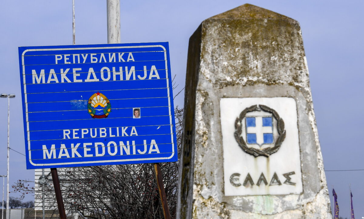 epa07363607 A Greek border stone and a sign reading 'Republic of Macedonia' stand next to each other at the border crossing between the FYR of Macedonia and Greece in Bogorodica, 11 February 2019 (issued 12 February 2019). The former Yugoslav Republic of Macedonia's government is due to change the name of the country after the ratification of the 'Protocol of the North Atlantic Treaty for the Accession of North Macedonia' whereby Greece will approve the accession of its northern neighbor to NATO under its new name, as provided by the Prespes Agreement signed by Athens and Skopje.  EPA/GEORGI LICOVSKI