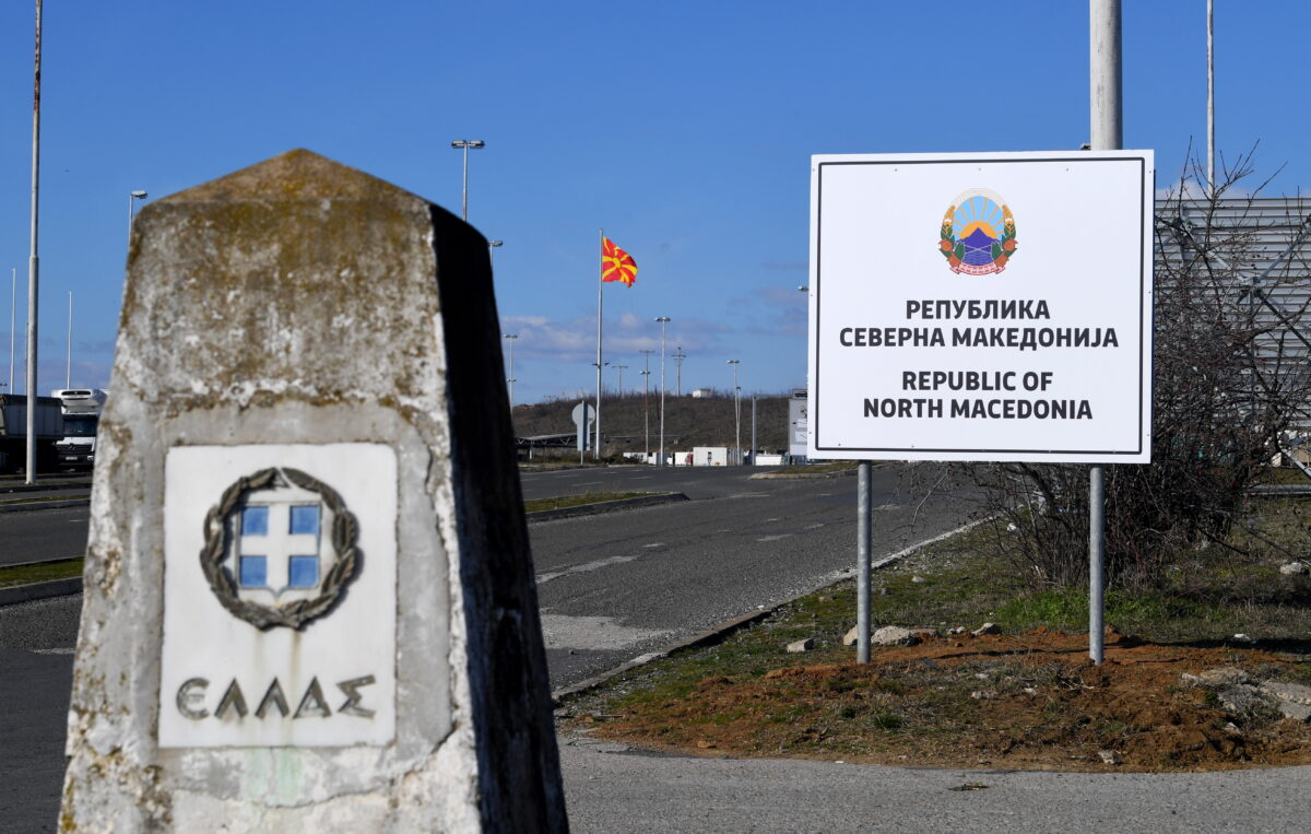 epa07366646 A Greece's border stone (L) and the new country name North Macedonia sign board (R) at the border crossing Bogorodica between North Macedonia and Greece on 13 February 2019. FYR of Macedonia Government is due change the name of country after ratification of the Protocol of the North Atlantic Treaty for the Accession of Republic of North Macedonia whereby Greece will approve the accession of its northern neighbor to NATO under its new name, as provided by the Prespes Agreement signed by Athens and Skopje.  EPA/GEORGI LICOVSKI